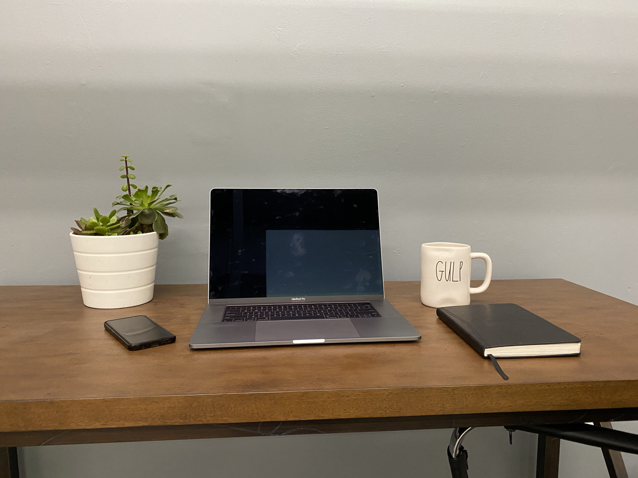 This is a photo of a desk with a laptop in the private offices available